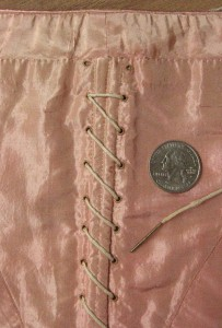 Tiny faux lacing center back closure